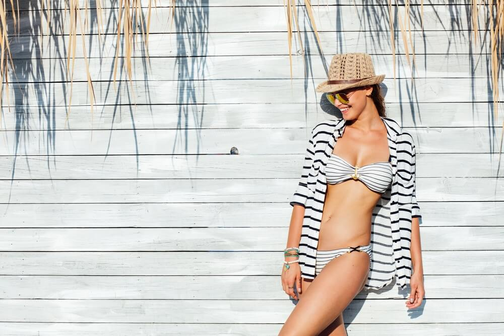 young sexy woman wearing hat sunglasses
